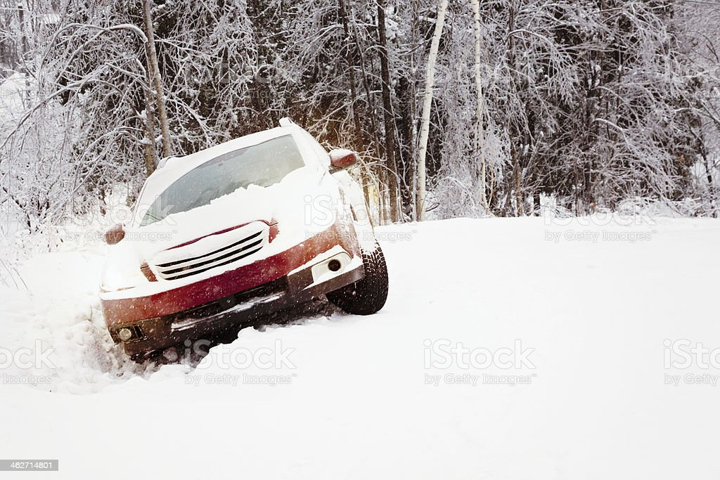 Winter snow accident car in a ditch stock photo