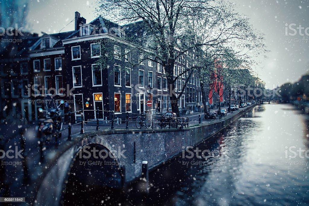 Winter snow christmas lights in Amsterdam, Netherlands stock photo