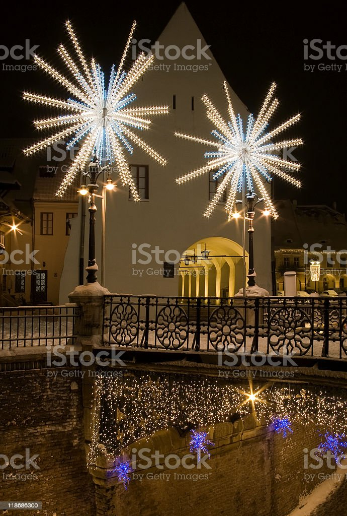 winter snow christmas lights in town square and street Sibiu royalty-free stock photo
