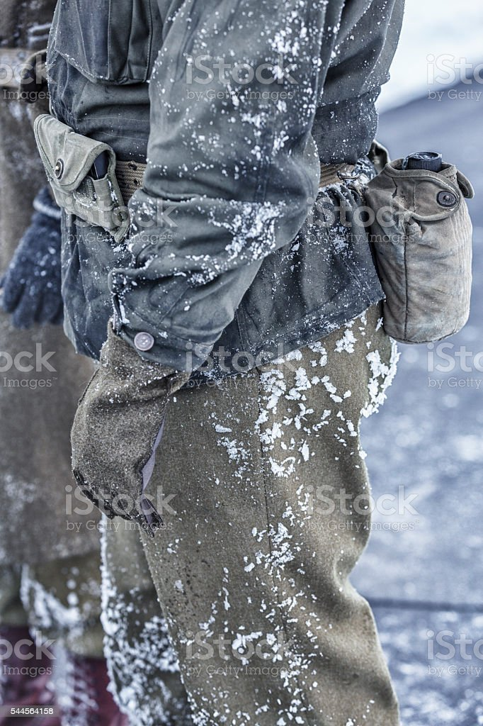 Winter Snow Covered WWII US Army Soldiers Waiting For Orders stock photo