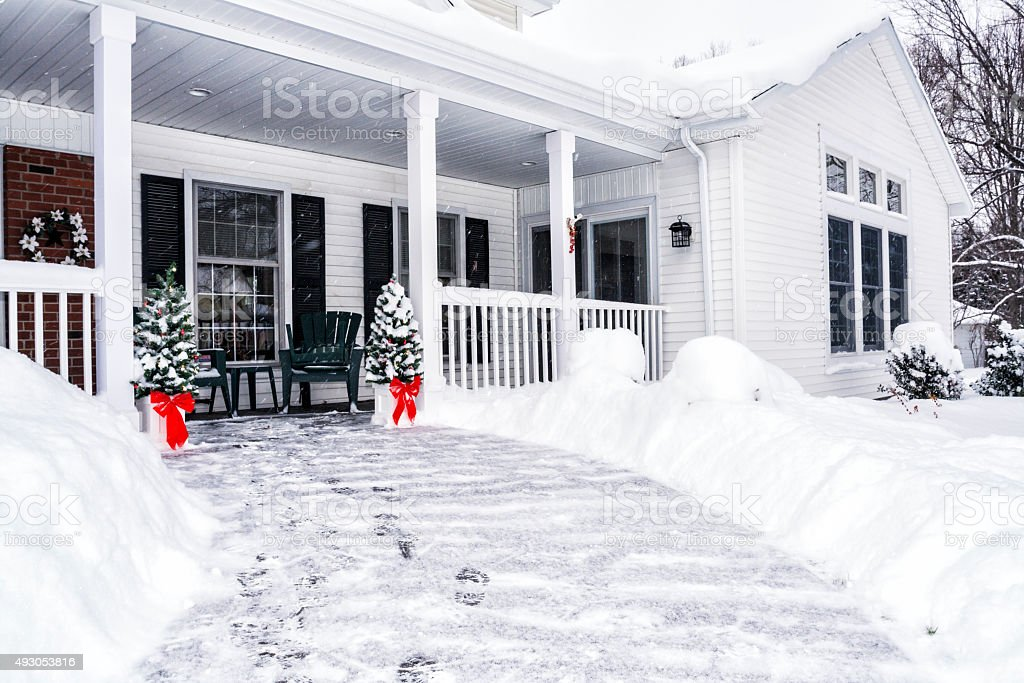 Winter Snow Footsteps on House Front Walkway stock photo