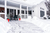 Winter Snow Footsteps on House Front Walkway
