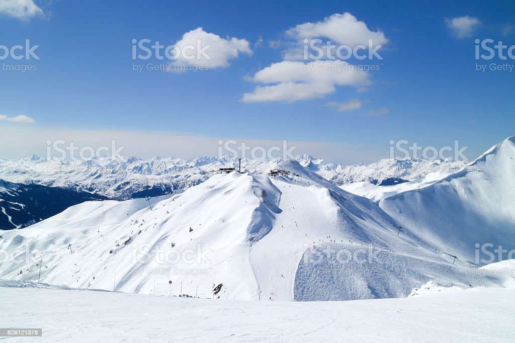 Winter snow landscape in high mountains with ski pistes stock photo