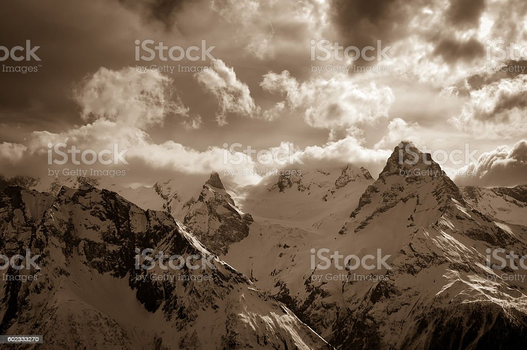 Winter snow mountains in clouds stock photo