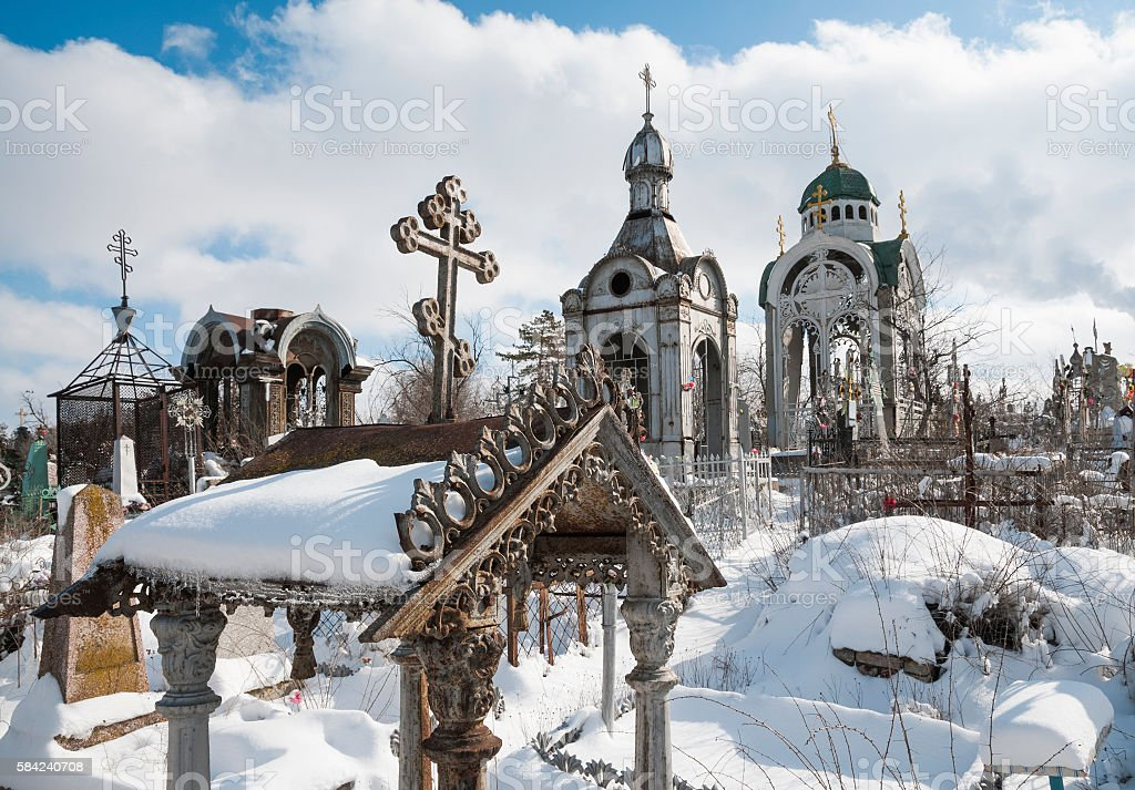 Winter, snow, old tombstones at the old Russian Orthodox cemetery. stock photo