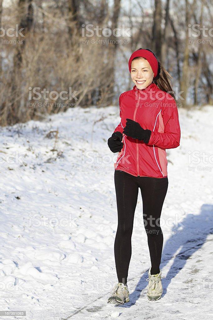 Winter snow runner woman royalty-free stock photo
