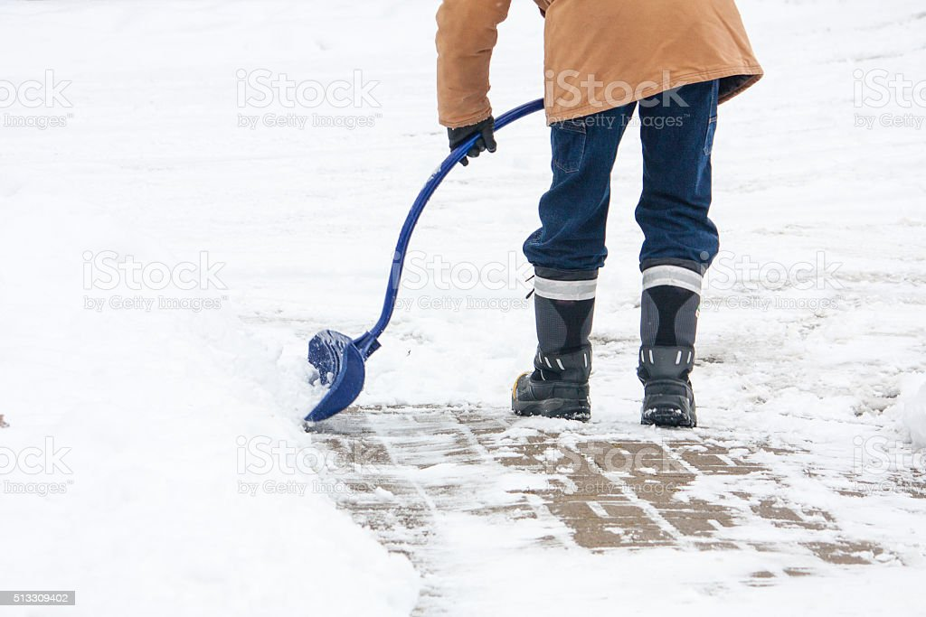 Winter snow shovelling stock photo