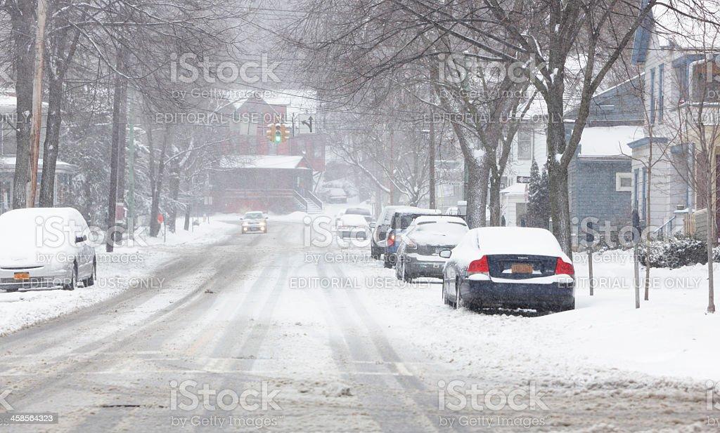 Winter Snow Storm on City Street in Ithaca, New York stock photo
