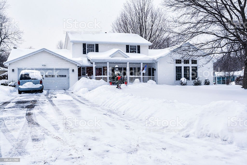 Winter Snow Storm Suburban Driveway And Home stock photo