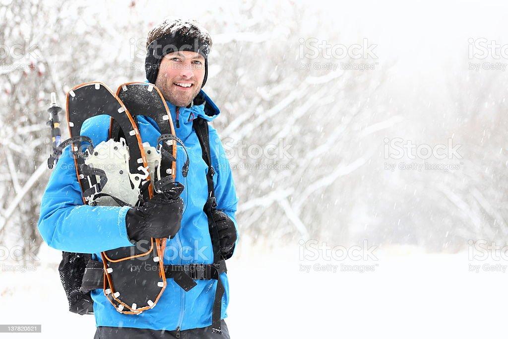 Winter snowshoeing man royalty-free stock photo