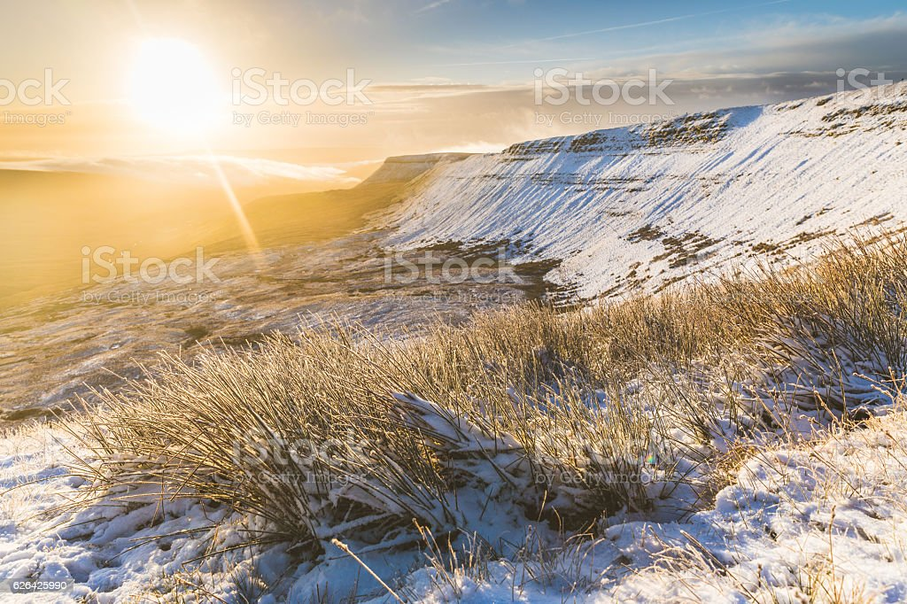 Winter snowy landscape at sunrise in Wales stock photo
