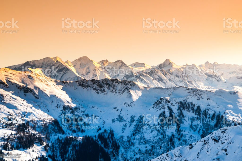 Winter snowy peaks of Alps. Mountain panorama illuminated by sunset at evening time. Austria and Switzerland, Europe stock photo