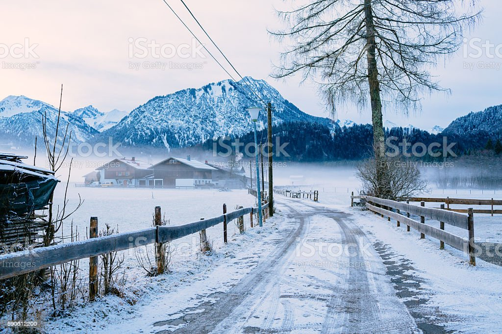 Winter snowy road in a small bavarian village stock photo
