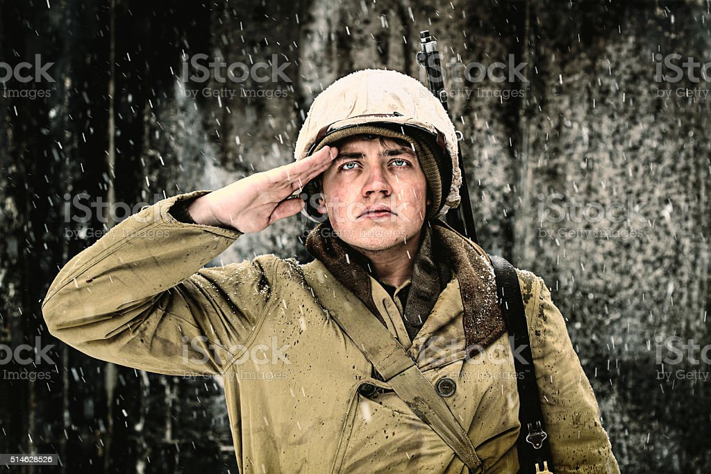WWII Winter Soldier Saluting stock photo