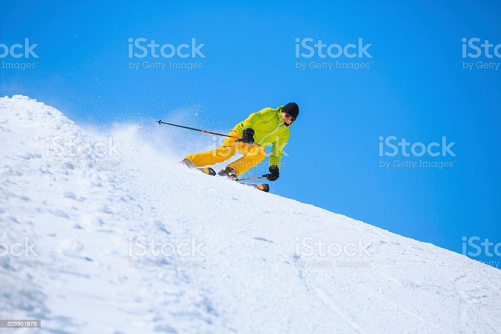 Vital senior men snow skier skiing, enjoying on sunny ski resorts....
