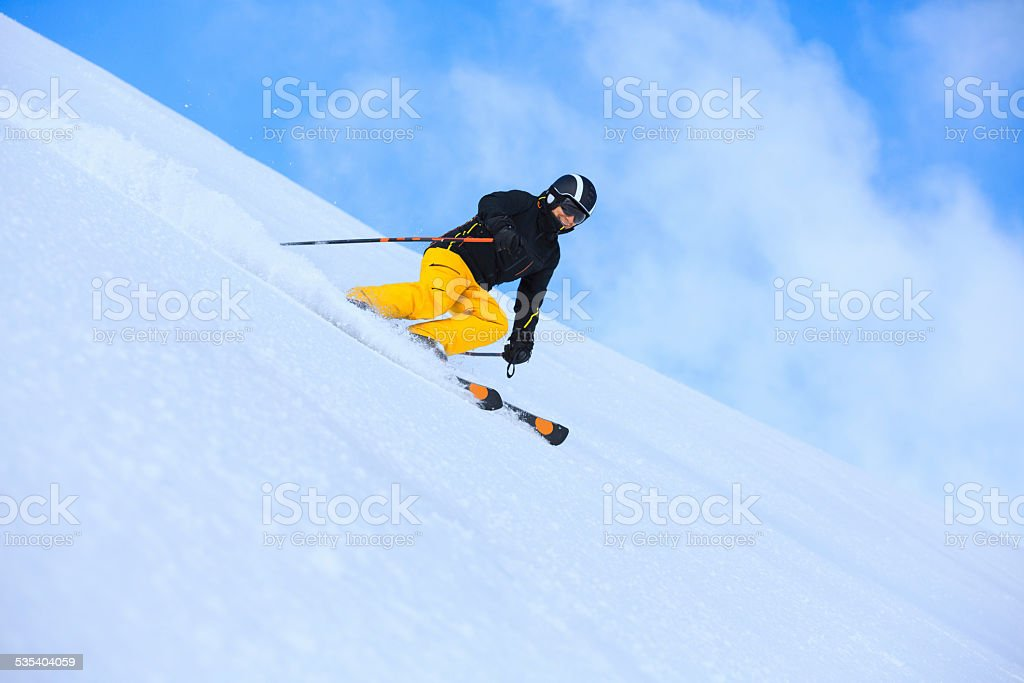 Winter sport. Beautiful senior men snow skier skiing, enjoying on...