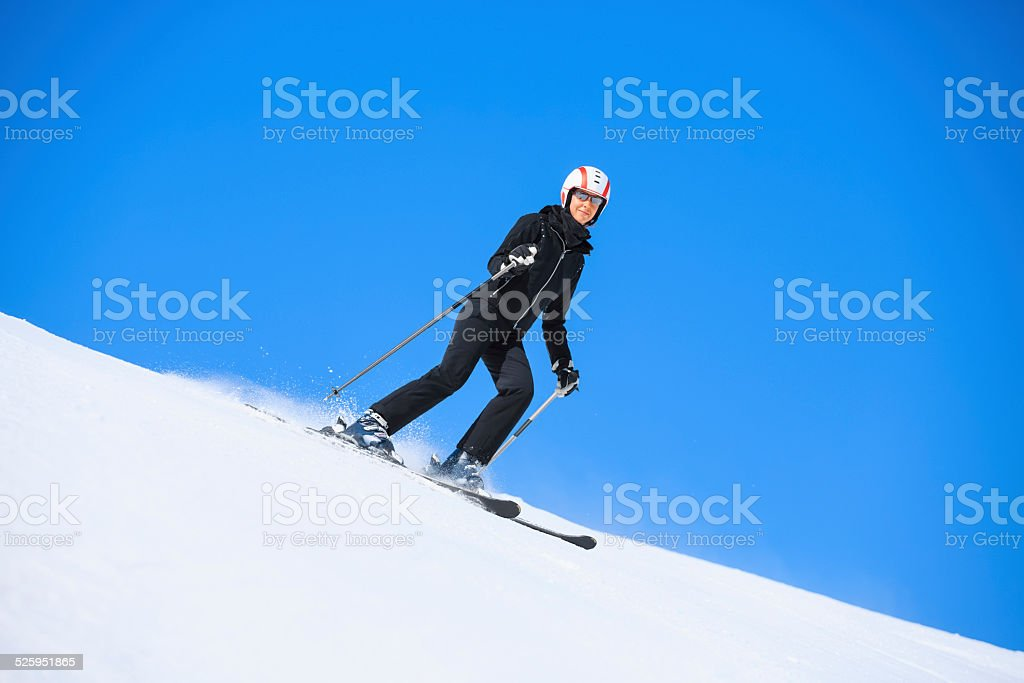 Winter sport. Women snow skier, skiing, enjoying on sunny ski...