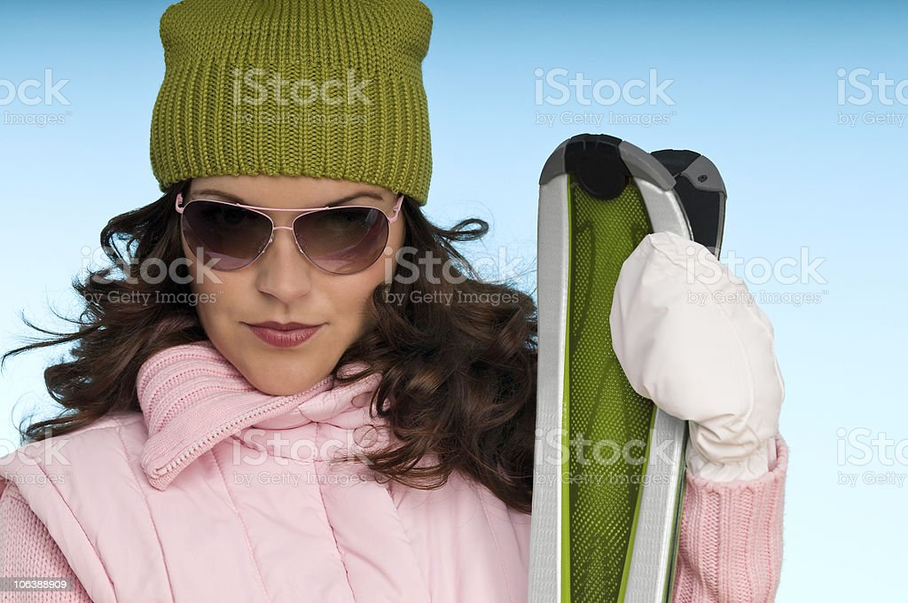 Winter sports series - Woman in pink and green royalty-free stock photo