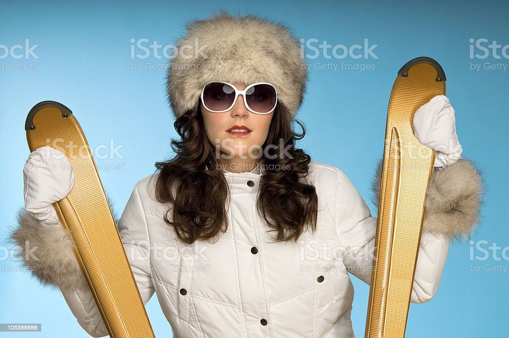 Winter sports series - Woman with golden skis royalty-free stock photo