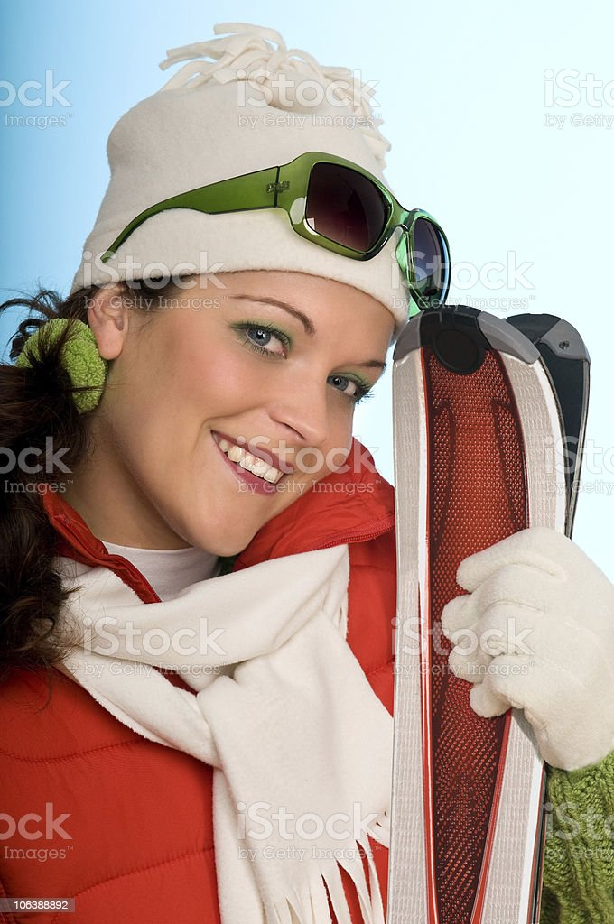 Winter sports series - Young woman with red skis royalty-free stock photo