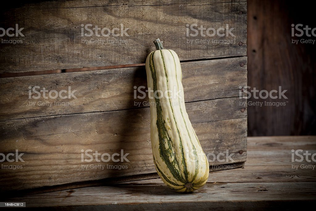 Winter Squash on display weathered wood surface stock photo