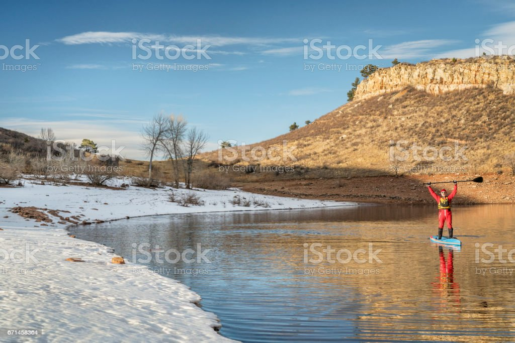 winter stand up paddling in Colorado stock photo