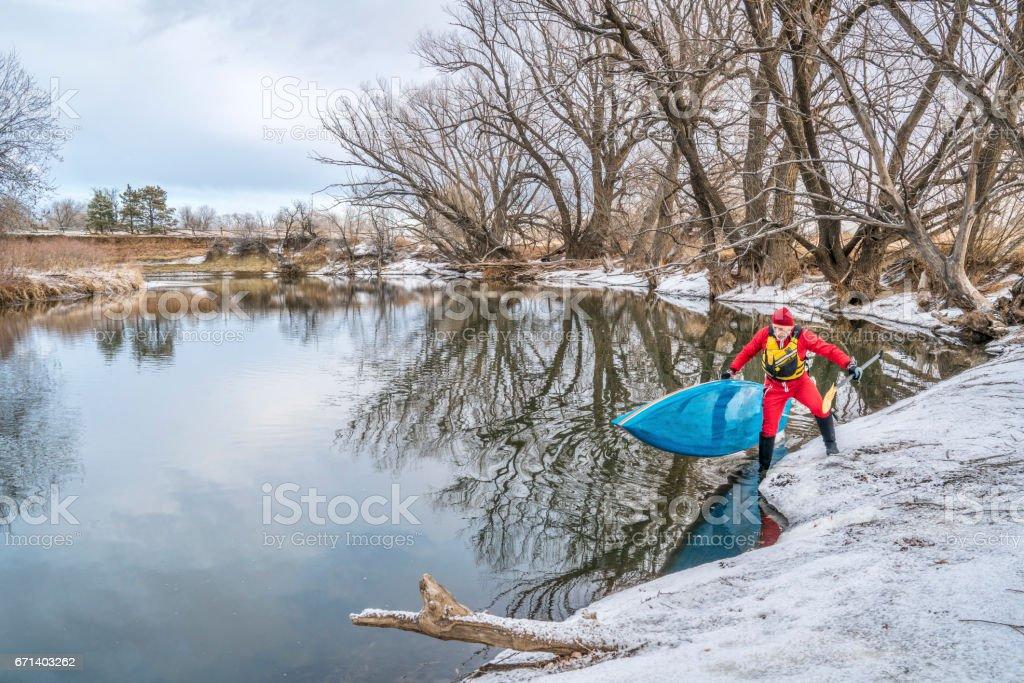 winter stand up paddling stock photo