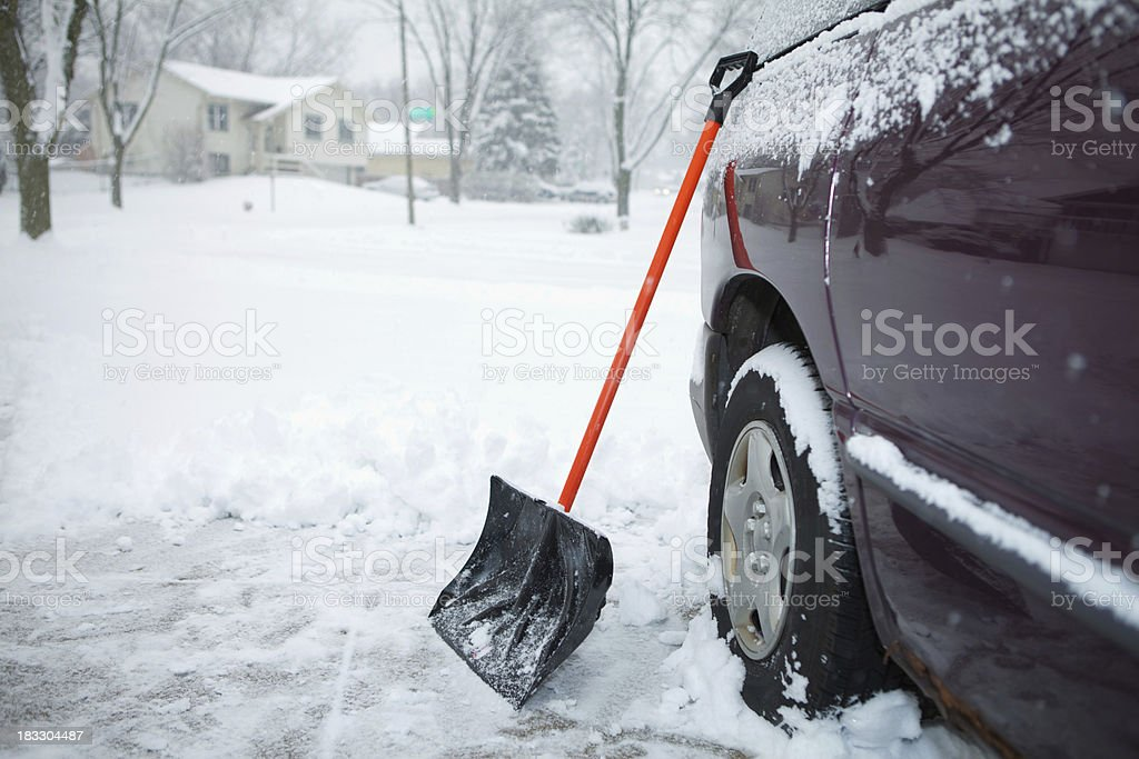 Winter Storm and Snow Shovel on Driveway stock photo