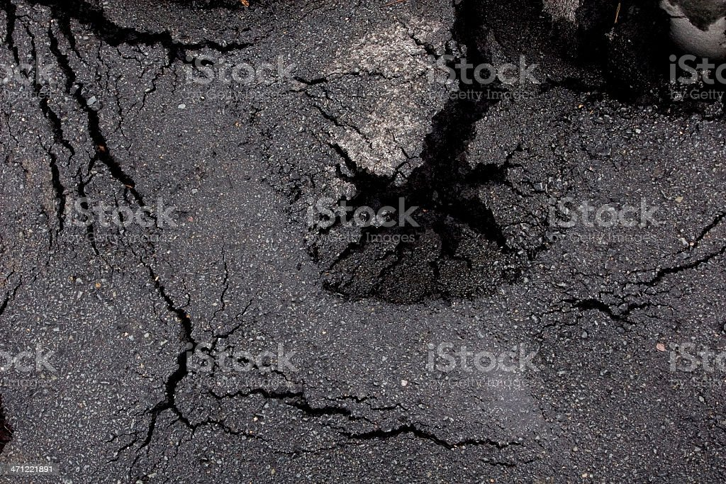 Winter Storm Cracks Pavement stock photo