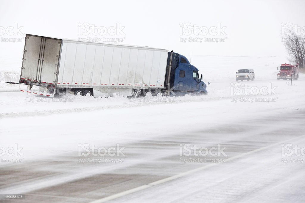 Winter Storm Semi Truck Accident in Highway Median stock photo