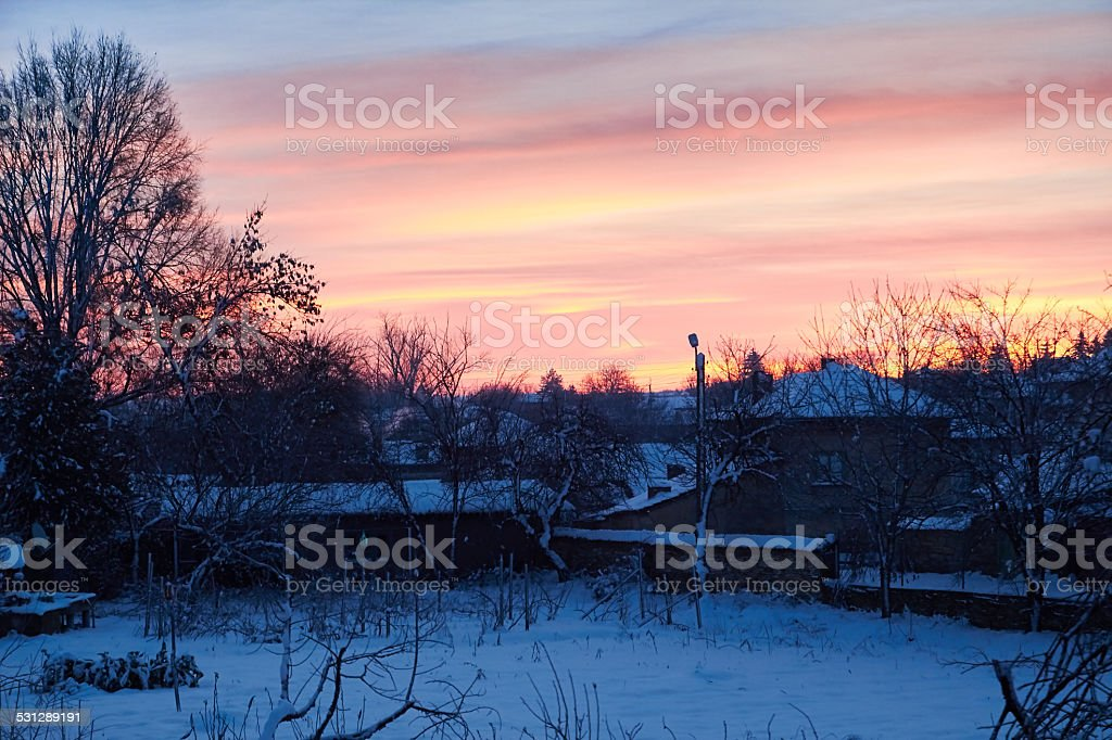 winter sunrise in the village royalty-free stock photo