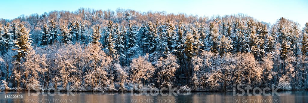 Winter Sunrise Over a Lake and Frosty Trees stock photo