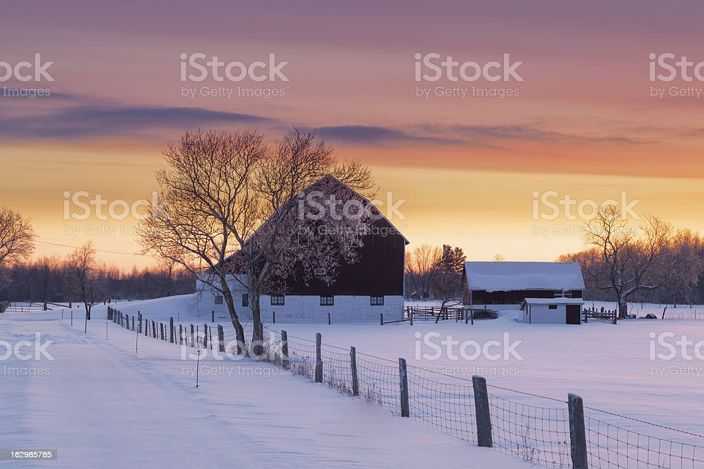 Winter sunrise over barn with snow  royalty-free stock photo