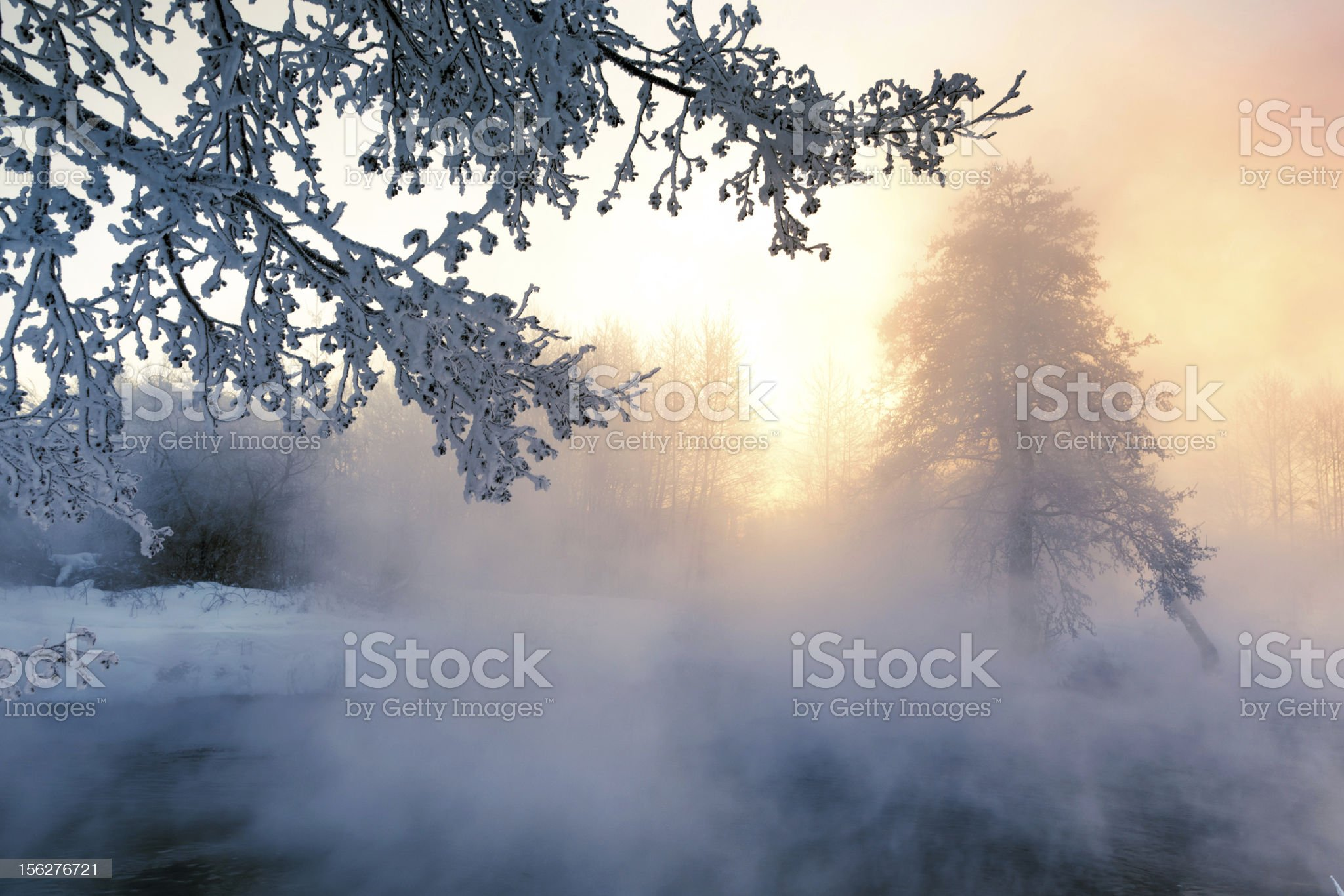 Winter sunrise over foggy non-freezing river royalty-free stock photo