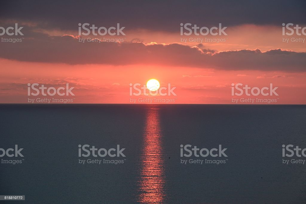 Winter sunset at Golden Bay in Malta. stock photo