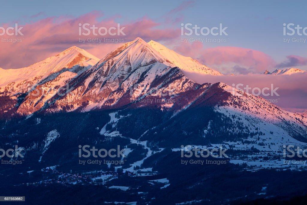 Winter sunset on Petite and Grande Autane, Champsaur, Alps, France stock photo