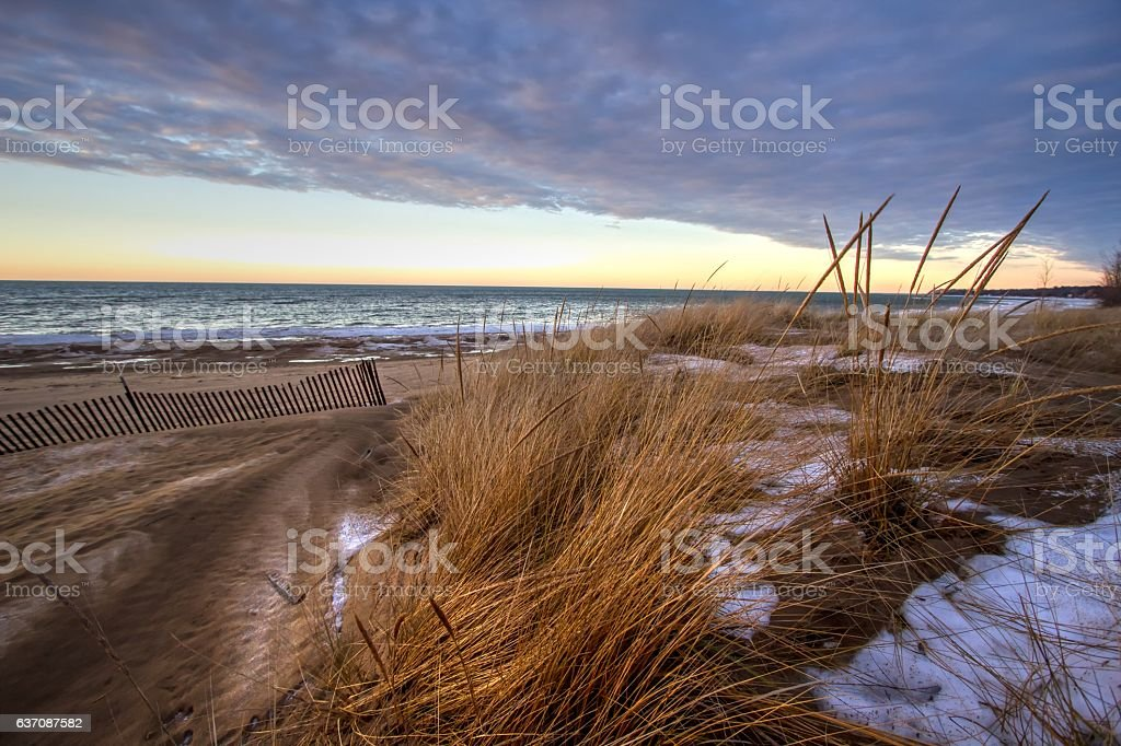 Winter Sunset On The Great Lakes Coast stock photo