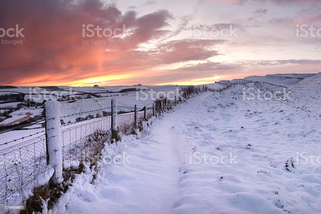 Winter Sunset over Maiden Castle in Dorset stock photo