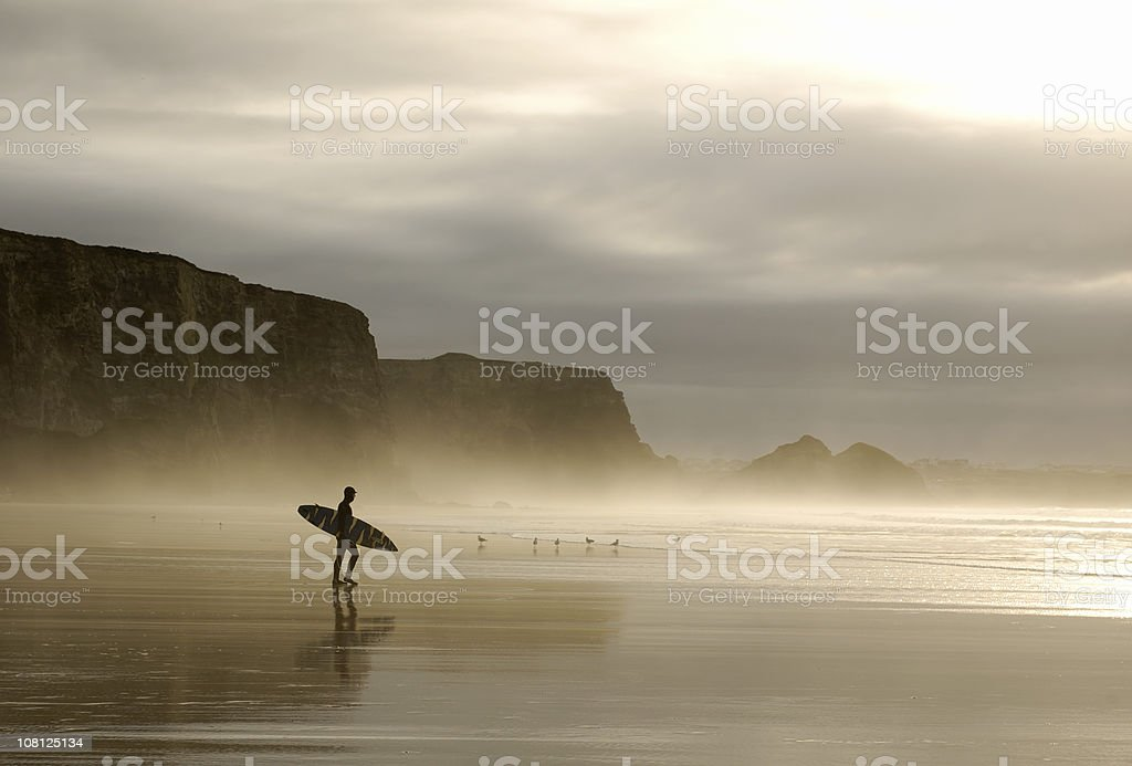 winter surfer in cornwall stock photo