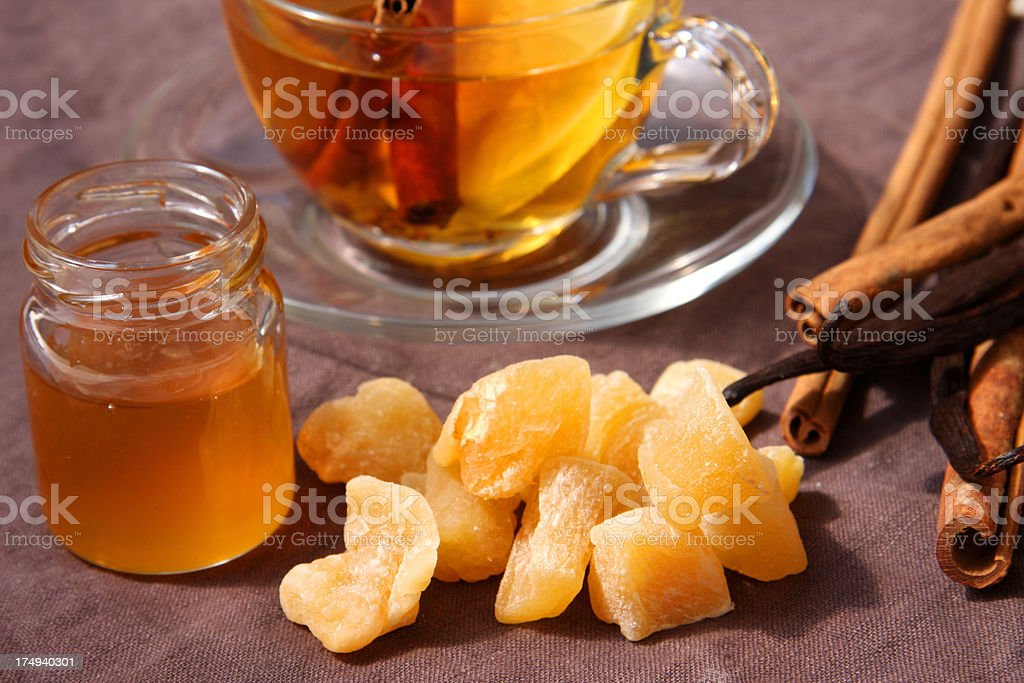 Winter tea with lemon, honey, cinnamon and ginger candies royalty-free stock photo