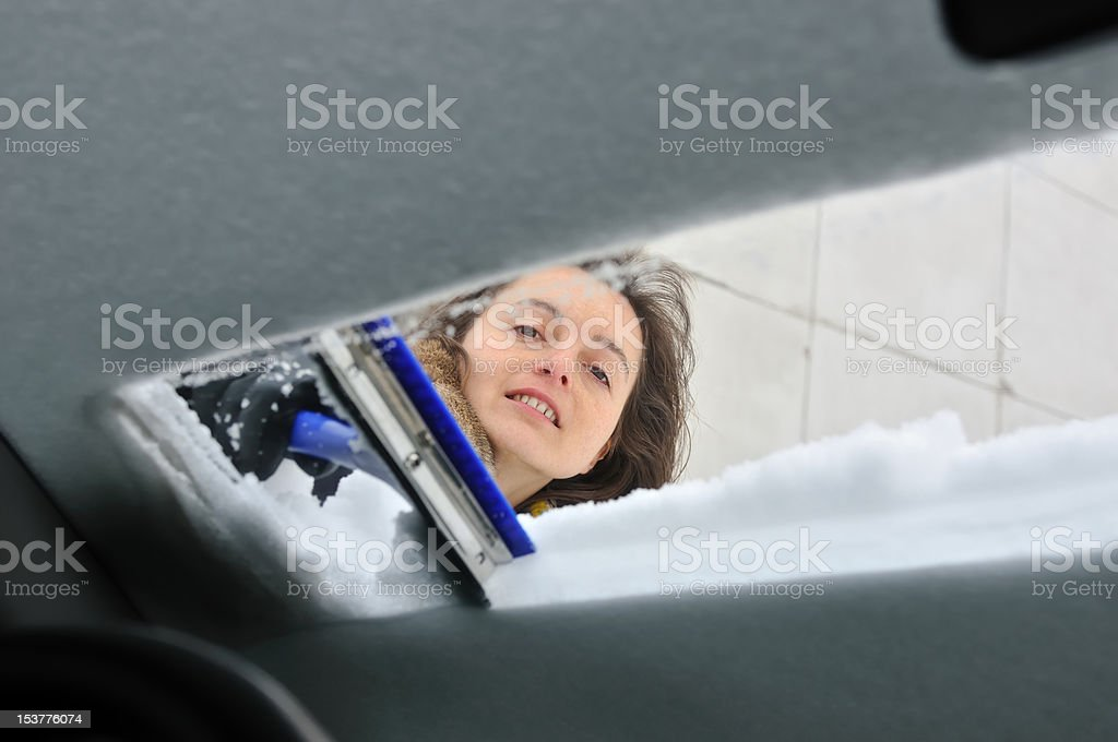 Winter time - person cleaning car royalty-free stock photo