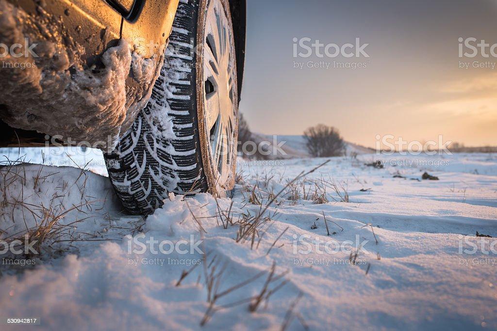 Winter tires in snow stock photo
