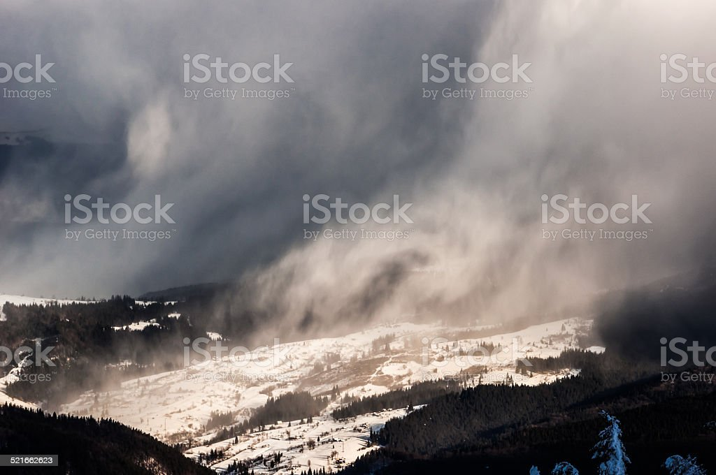 Winter trees in mountains covered with fresh snow stock photo