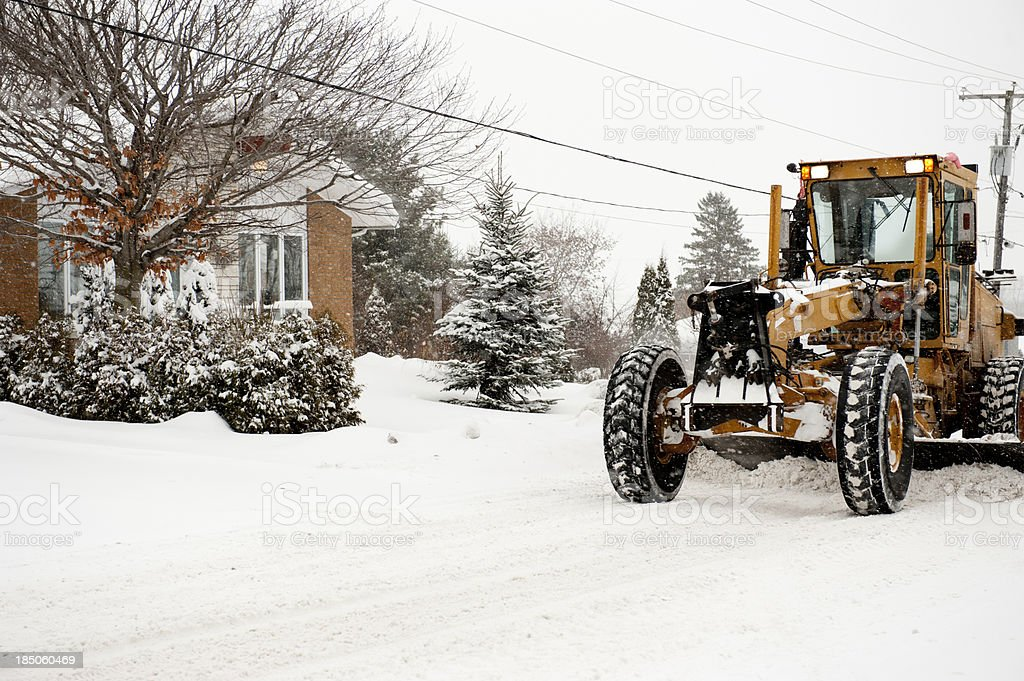 winter truck grader snow removal  in storm, hivers canada, quebec royalty-free stock photo