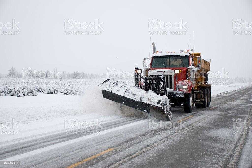 winter truck snow removal spreader in storm, hivers canada, quebec stock photo