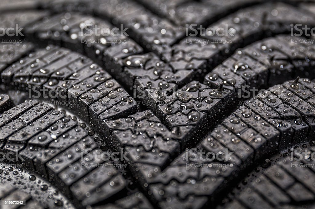 Winter tyre close-up with water drops stock photo
