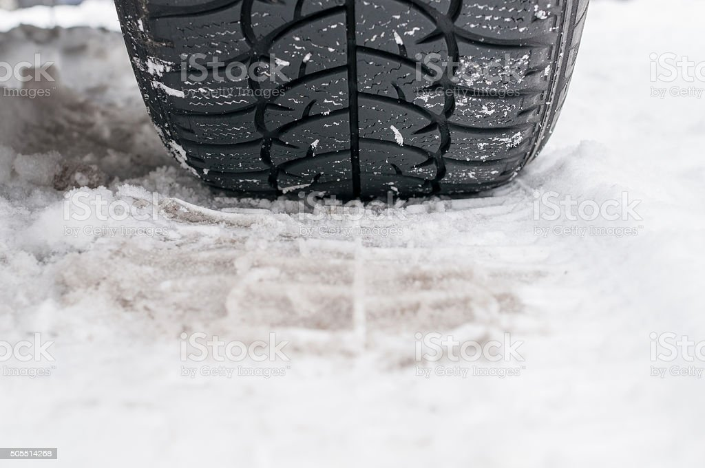 Winter tyre on the road stock photo