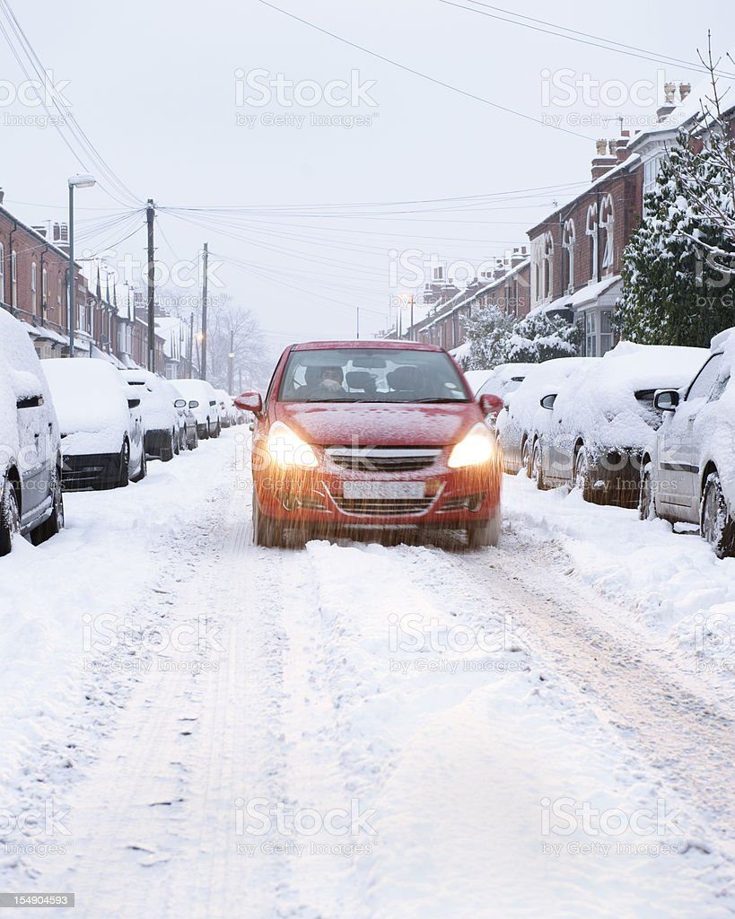 Winter urban driving in snow at dusk royalty-free stock photo