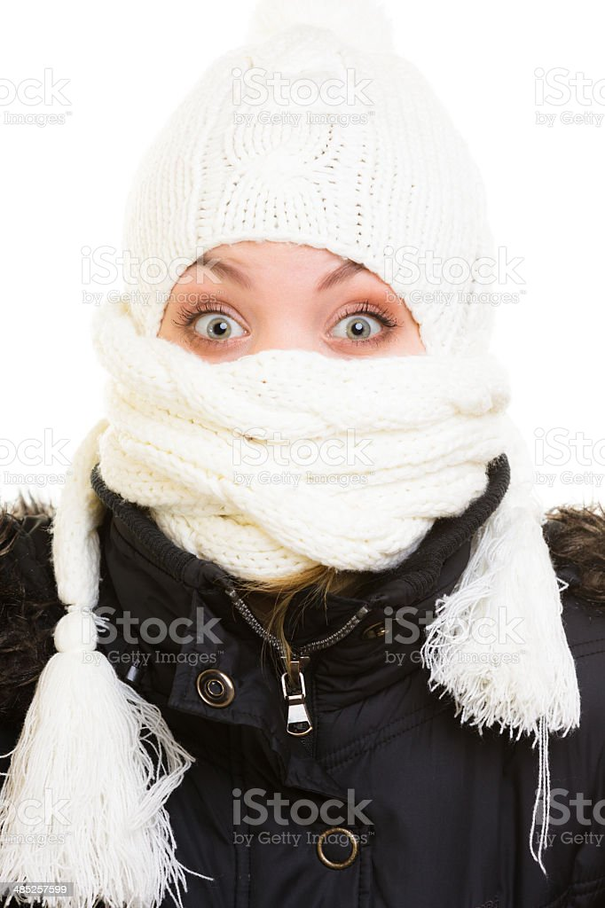 Winter vacation. Girl covering face with scarf. stock photo