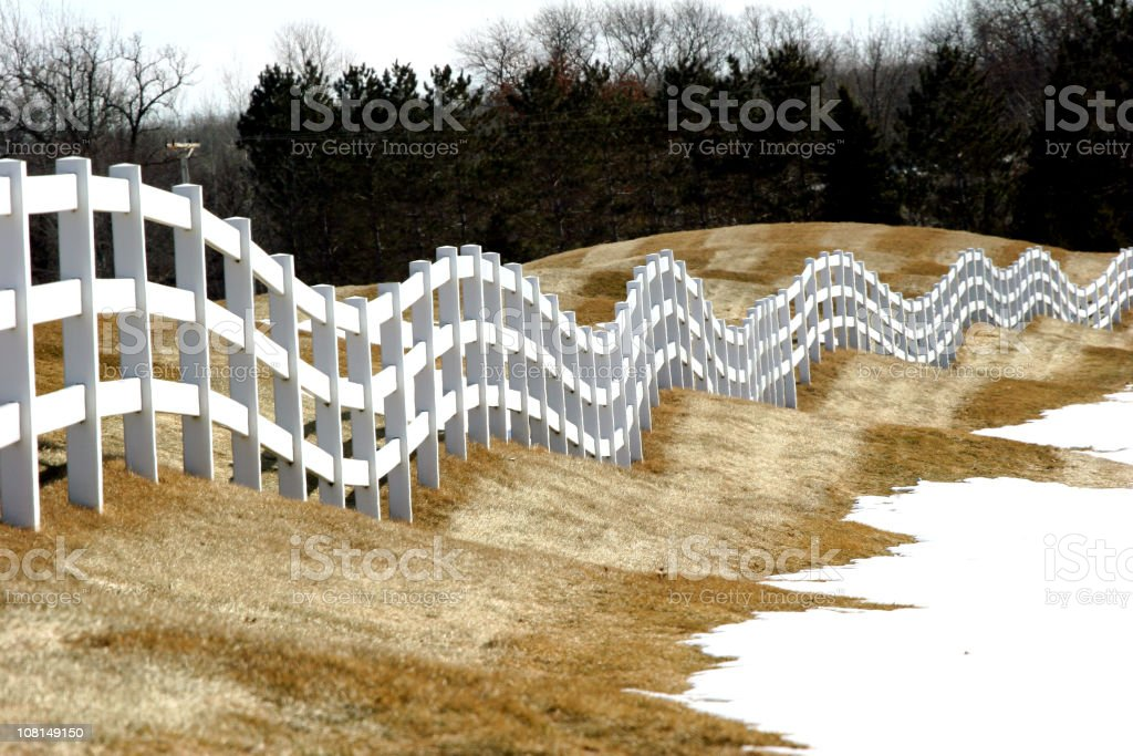 Winter View of Rolling Hills with White Fence royalty-free stock photo